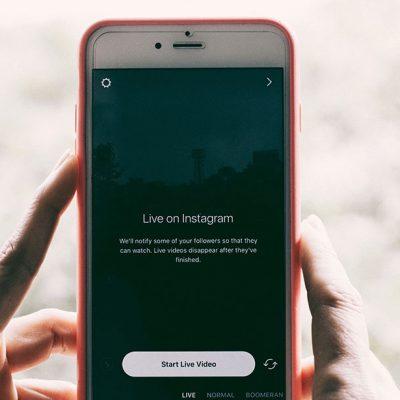 social media, hands holding phone